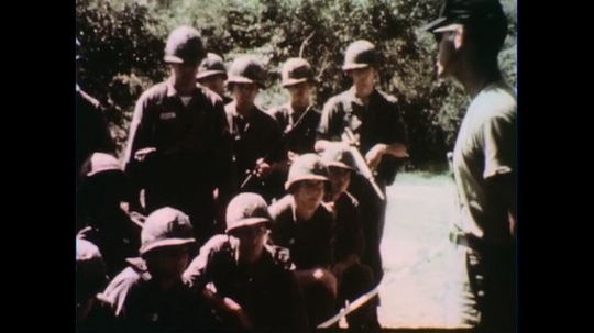 VIETNAM 1960s: Officer speaks to group of soldiers.