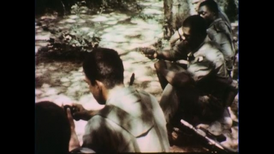 VIETNAM 1960s: Seated soldiers with mines / Officer speaks, holds mine / Seated soldiers.