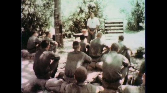 VIETNAM 1960s: Officer speaks in front of soldiers / Soldiers train with guns.