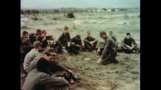 VIETNAM 1960s: Soldiers sitting in circle, soldier gives instructions.