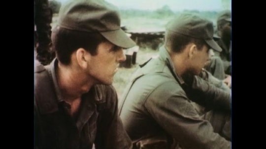 VIETNAM 1960s: Close up of soldiers sitting / Soldiers in circle, soldier gives instructions, zoom in on instructor.