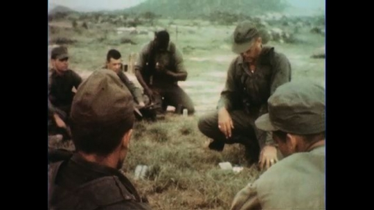 VIETNAM 1960s: Soldiers seated, instructor in middle / Soldier gives instructions.