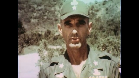 VIETNAM 1960s: Close up, general speaks into camera.