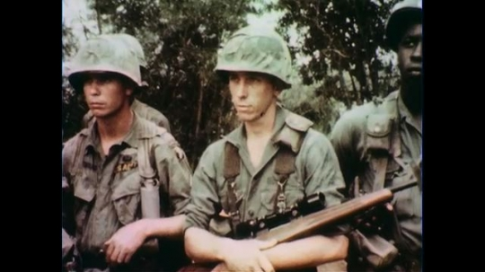 VIETNAM 1960s: Soldiers standing / Officer speaks, soldiers in foreground / Close up of soldier / Officer speaks.