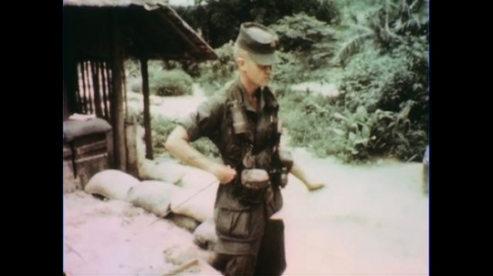 VIETNAM 1960s: Officer gives orders, pan to soldiers listening.