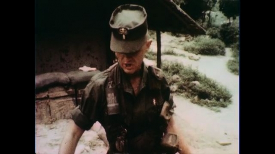 VIETNAM 1960s: Officer gives orders, tilt down to aerial map, pointer / Soldiers inspect guns.