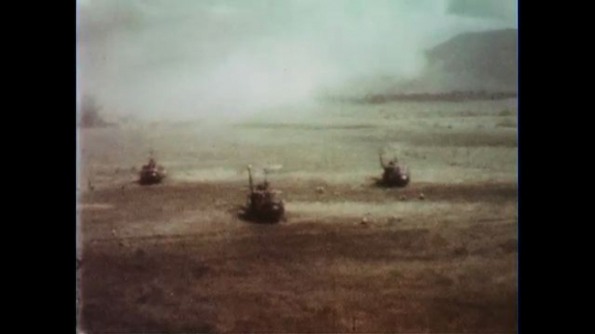 VIETNAM 1960s: Aerial views of helicopters taking off, soldiers in field.