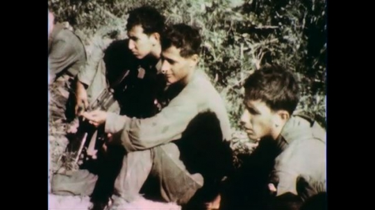 VIETNAM 1960s: Views of soldiers sitting, talking / Dissolve to officer with soldier.