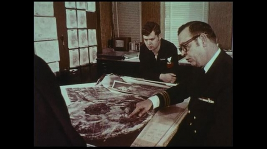 UNITED STATES 1970s: Satellite images and weather forecasts are transmitted to other weather agencies.