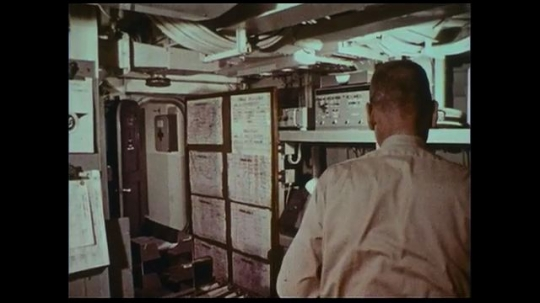 UNITED STATES 1970s: A naval officer follows his superior who is about to depart to give him a message.
