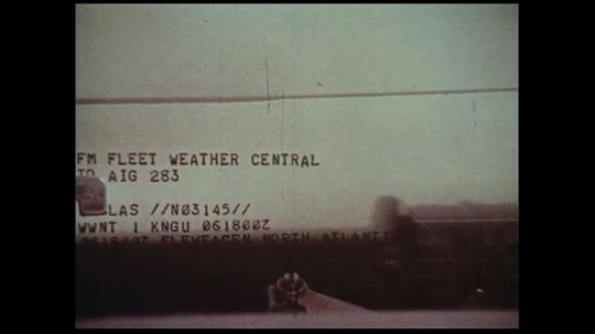UNITED STATES 1970s: A typist types weather information from the weather central to be transmitted to other concerned agencies.