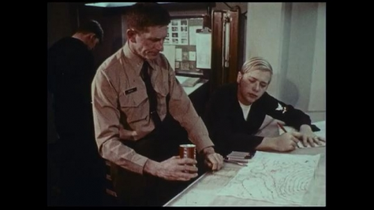 UNITED STATES 1970s: A naval chief informs his crew of his expectations in the sea.