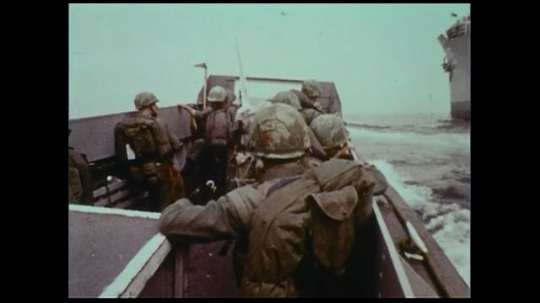 UNITED STATES 1970s: Naval officers take a small boat to shore and run out quickly, suited for warfare.