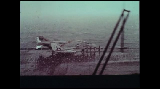 UNITED STATES 1970s: As the rain pours, the visibility from a war ship's deck is minimal.