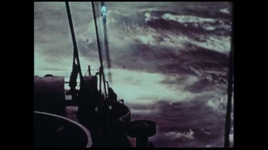 UNITED STATES 1970s: Large waves crash into a ship as it the rain keeps pouring.