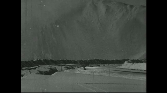 UNITED STATES: 1940s: land covered with powder. Machines in mill.