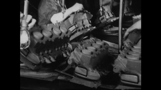 UNITED STATES 1930s-1940s : Workers clean and polish v8 engine blocks.