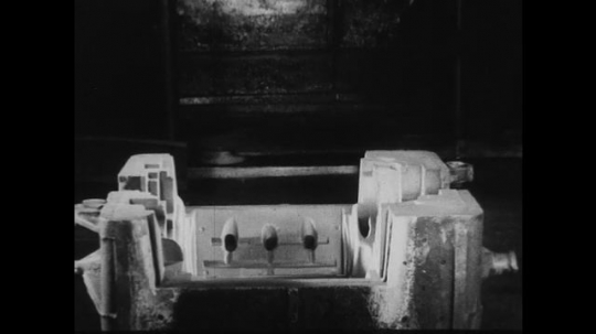 UNITED STATES 1930s-1940s : Crossfades show the piece-by-piece construction of a V8 engine block.