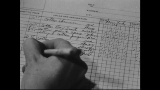 AMERICA: 1950s: A man writes in a ledger. An early computer display with flashing lights and knobs.