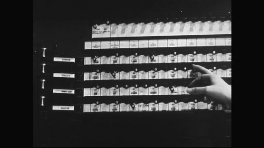 UNITED STATES 1960s: Hand making selections on voting machine / Close up of hand pulling lever / Woman opens curtains of voting booth.