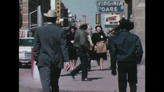 UNITED STATES 1960s: A slew of people walking through a busy sidewalk.