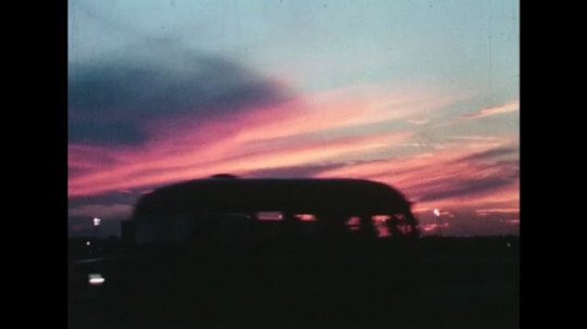 UNITED STATES 1960s: Performers entertain as sunset turns into night.