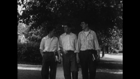 UNITED STATES 1950s: Three young men walk home together followed by home life and school life.