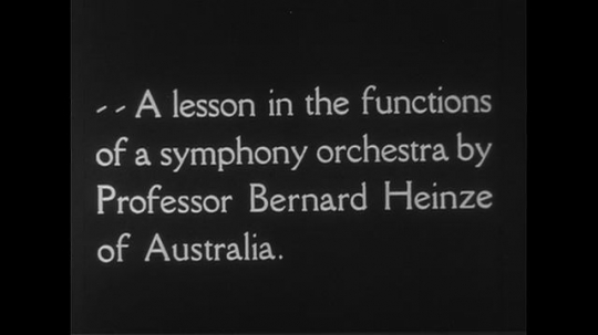 AUSTRALIA CIRCA 1951 : A lesson in the functions of a symphony orchestra by Professor Bernard Heinze of Australia.