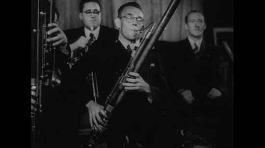 UNITED STATES CIRCA 1951 : A solo is played on the bassoon during a concert performance.