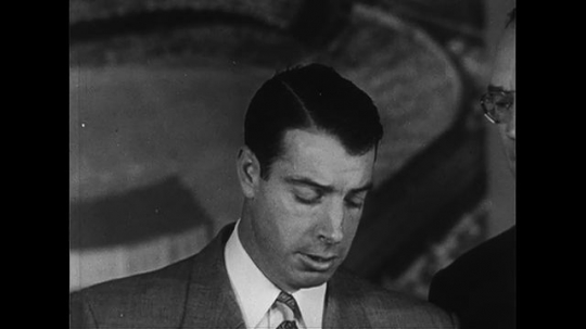 UNITED STATES CIRCA 1951 : During a press conference, Joe DiMaggio announces his retirement from baseball.