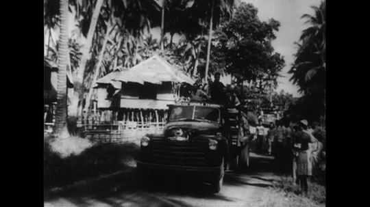 PHILIPPINES CIRCA 1951 : Refugees from Camiguin, Philippines are rescued.