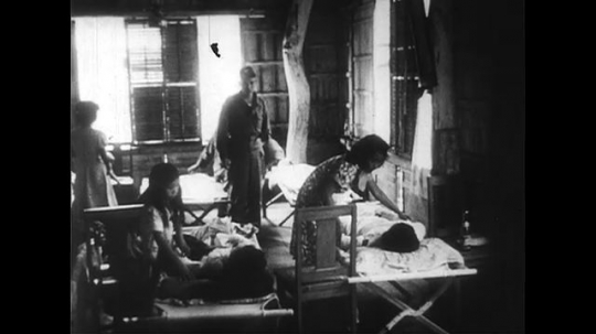 PHILIPPINES CIRCA 1951 : As patients are treated in makeshift hospitals, molten lava still scorches in Camiguin, Philippines.