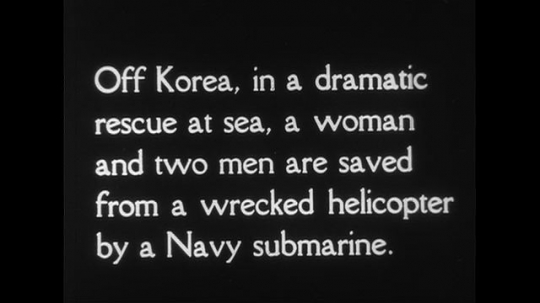KOREA CIRCA 1951 : Off Korea, a Navy submarine rescues two men and a women from a wrecked helicopter.