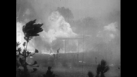 AUSTRALIA CIRCA 1951 : Flames in the Blue Mountain Region of New South Wales rage through towns from day to night and is not controlled.
