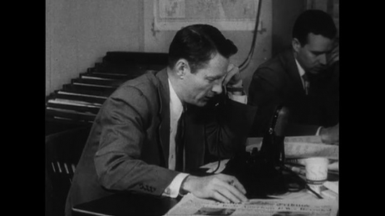 WASHINGTON DC CIRCA 1951 : A reporter announces the detainment of an American general as the war goes on in Korea.