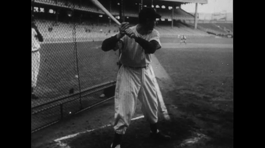 UNITED STATES CIRCA 1951 : Joe DiMaggio does hitting practice and then enters during opening day at Yankee Stadium.