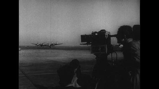 UNITED STATES 1950s: Plane lands, cameraman in foreground / Matthew Ridgway steps off plane / Ridgway with soldiers, officials / Plane on runway.