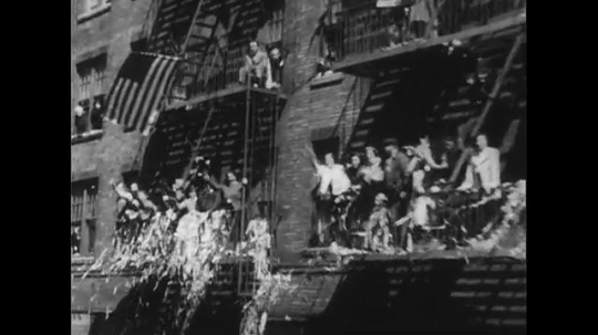 UNITED STATES 1950s: View from car of crowd cheering / Views of New York City street, ticker tape.
