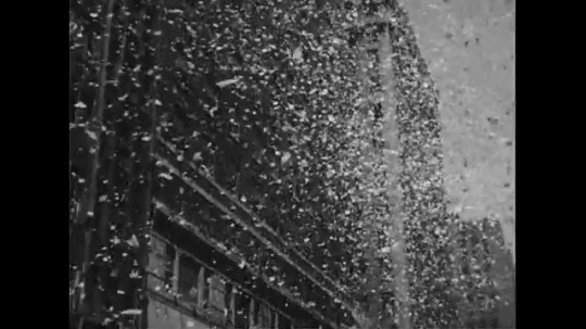 UNITED STATES 1950s: Ticker tape falls from building in New York City parade / Douglas MacArthur waves from car / Arthur MacArthur waves / View of crowd from car.