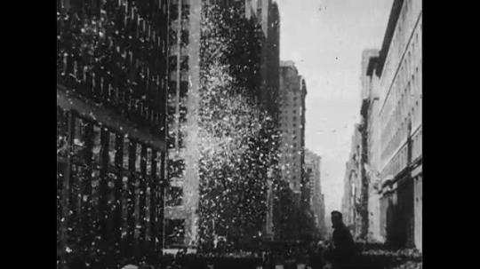 UNITED STATES 1950s: New York City parade, ticker tape / Douglas MacArthur waves from car / High angle view of parade, ticker tape.