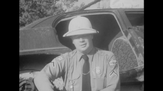 Accident Inspector Takes Notes and Talks to Camera.