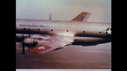 UNITED STATES: 1960s: USAF planes refuel in sky. View from inside plane