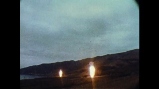 UNITED STATES: 1960s: Missiles launch into sky. Man with ophthalmoscope. USAF employees at work.