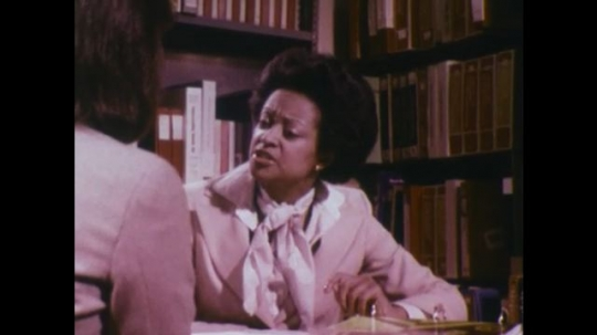 UNITED STATES 1970s: Women talk at desk / Close up, hands point to sections on paper / Woman talking at desk / Woman talking at desk.