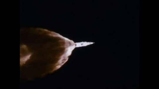 UNITED STATES 1960s: Long shot, rocket launching / Flames in sky / View from rocket, piece falling away / Long shot of rocket, flames / View from rocket, piece falling away.