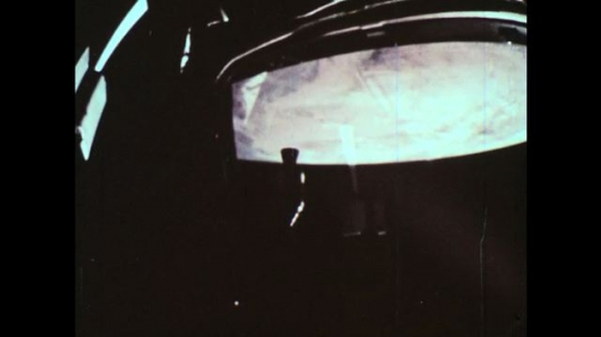 UNITED STATES, 1960s: View of planet and space through rocket window.