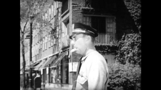 United States, 1940s: Police Officer in street. People doing manual work. Librarian hands book to children. Cars driving along highway. Sailors preparing for a display. Jury service document.