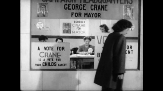 United States, 1940s: Lady walks past election window. Highlighted text reads 'take part in group activities'. Highlighted text reads 'know and obey the law'.