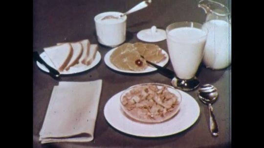 UNITED STATES 1960s: Breakfast foods on table / Grains on plates in studio, zoom in on grains.