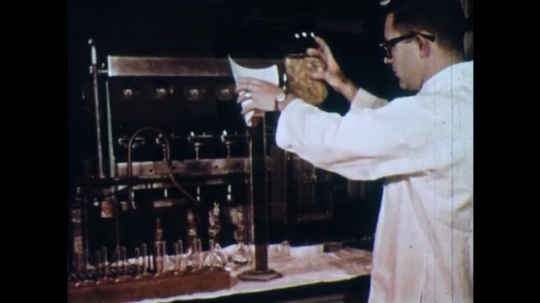 UNITED STATES 1960s: Man in lab, pours cereal into tube / Man pours cereal / Pan across display of cereals.